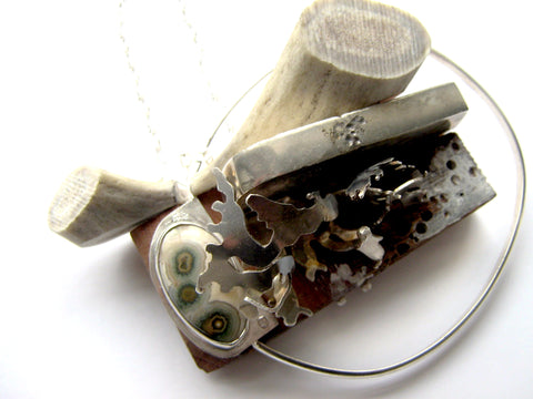 Necklace with cab stone, sterling silver, antler and wood from the Forerunner series by Meris Mosher.