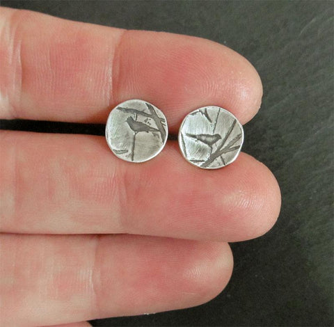 Tiny Bird on a Branch stud earrings in a softly brushed sterling silver finish.  10 mm wide