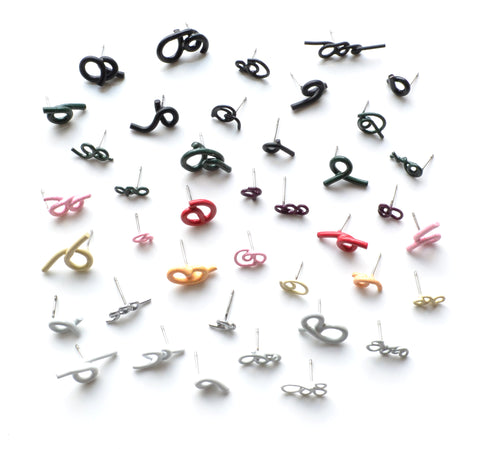Twist Earrings are powder-coated copper on surgical stainless steel posts. Each earring is sold individually so you can mix and match a much as you like. We have a wide selection of colours and forms in the gallery!
