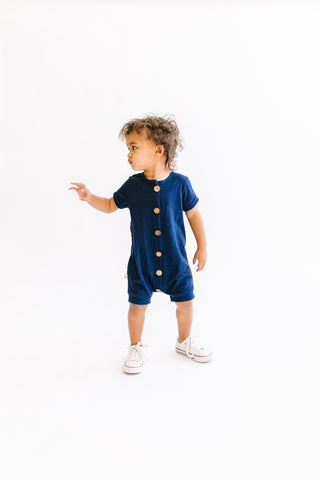 jersey rolled sleeve romper in 'navy'