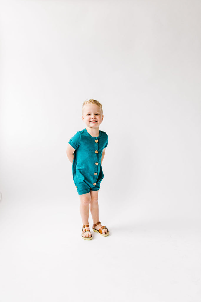 jersey rolled sleeve romper in 'peacock'
