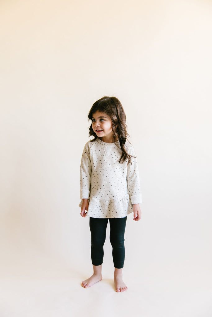 peplum crew in 'dots' on oatmeal