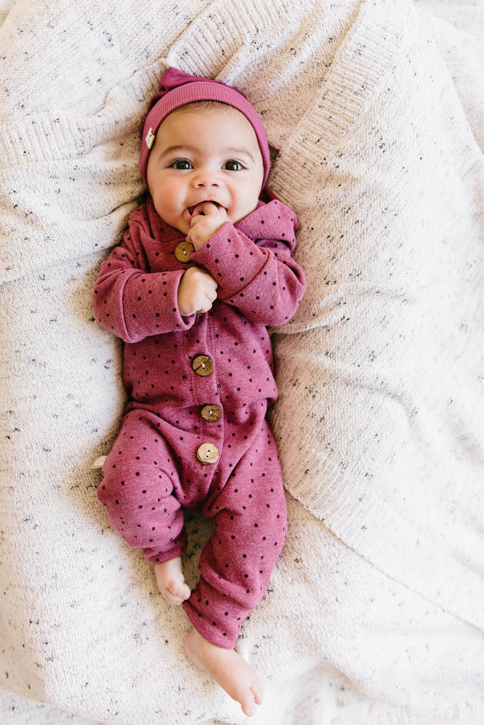 hooded romper in 'dots' on sangria