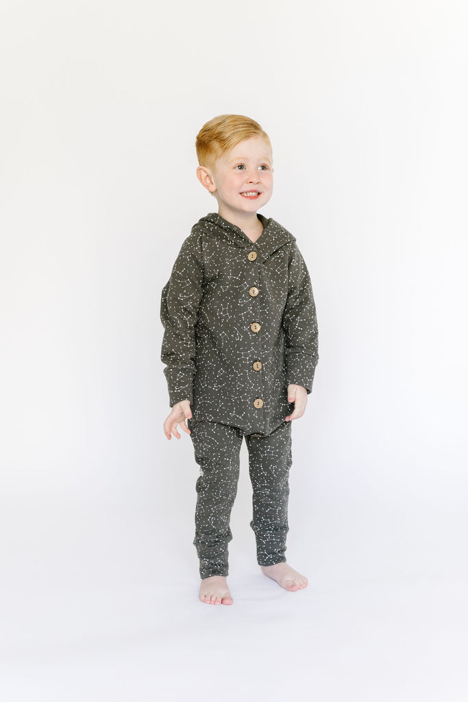 hooded romper in 'constellations' on faded black
