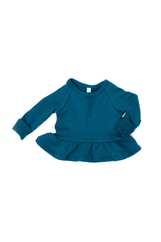 Peplum crew in 'peacock'