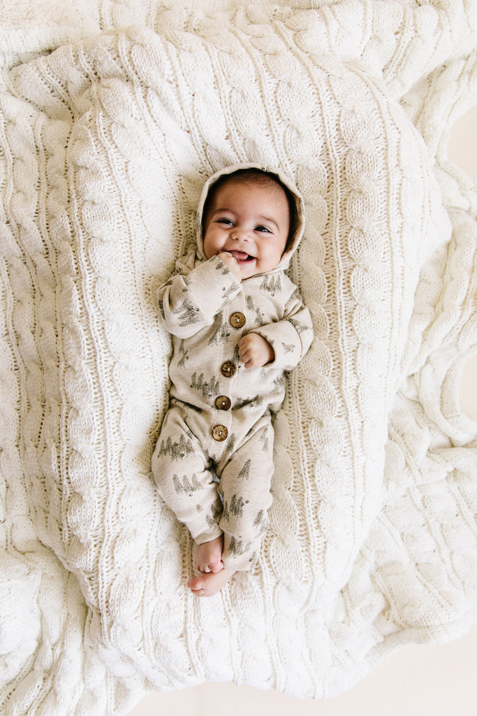 hooded romper in 'trees' on oatmeal
