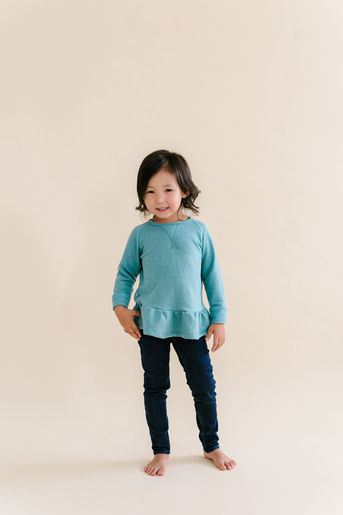 peplum crew in 'oil blue'