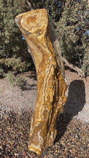Caramel Canyon Onyx stone fountain made by The Rock Star Gallery in garden setting