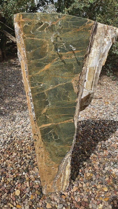 Black Canyon Onyx with green veining stone fountain by The Rock Star Gallery in stone garden landscape design.