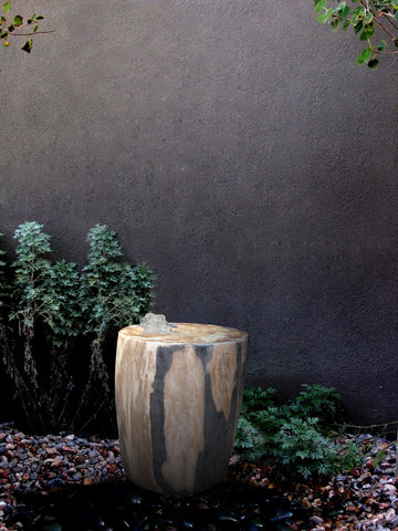 Petrified Wood Stone Fountain by The Rock Star Gallery in courtyard landscape design.