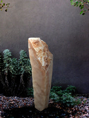 Sunrise Onyx Stone Sculpture with internal LED lighting for interior design or landscape design setting.