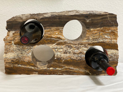 Stone wine bottle holder from The Rock Star Gallery is made from onyx and holds four bottles of wine.