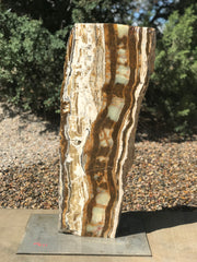 Verde Canyon Onyx stone fountain by The Rock Star Gallery in a landscape setting..