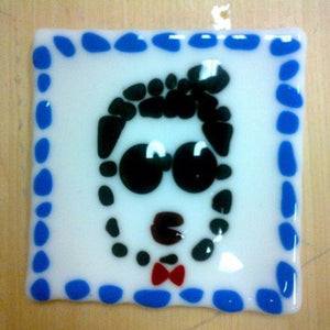 pointalist face wearing sunglasses with blue dot boarder glass fused coaster