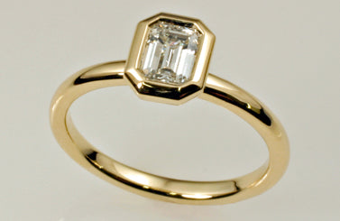 1. Emerald Cut Diamond Solitaire Engagement Ring