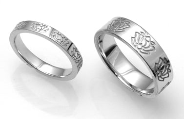 1. Lotus Motif Wedding Band Set