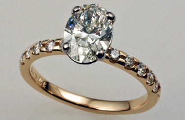 1. Oval Diamond Solitaire Plus Engagement Ring