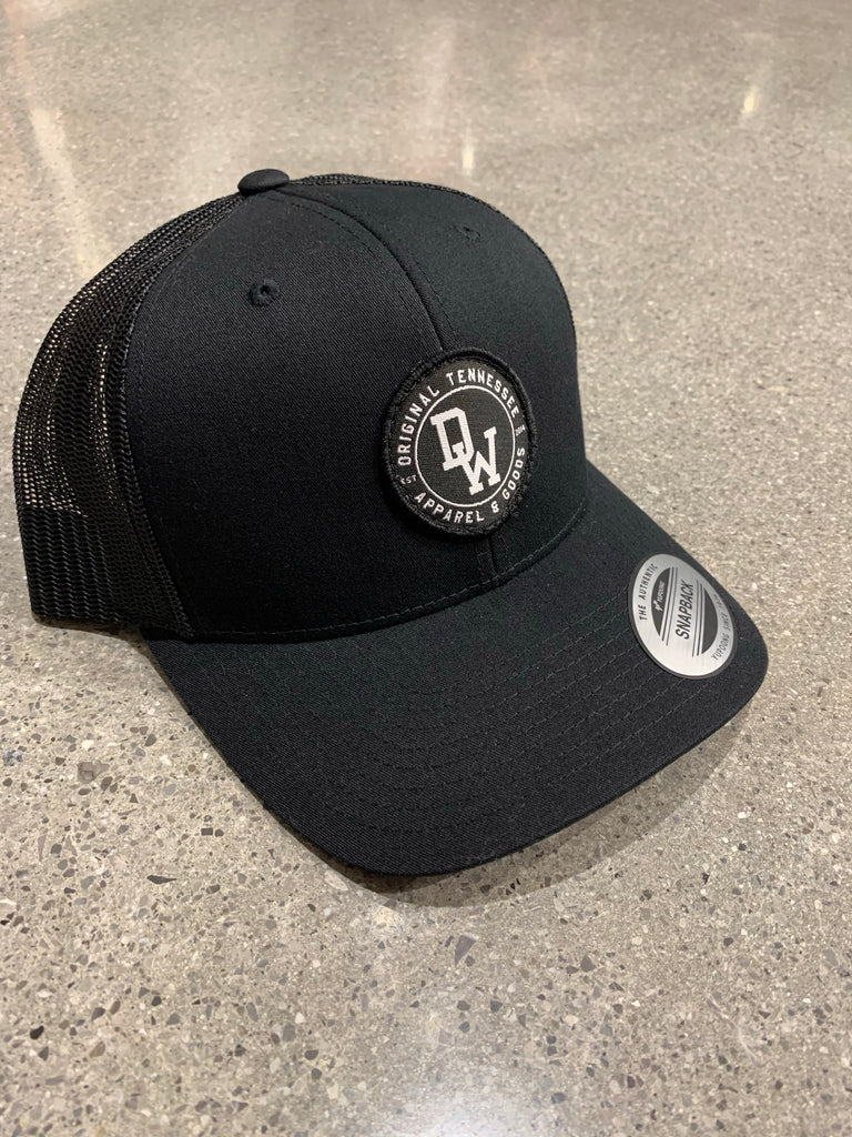 The DW Circle Patch Trucker Hat - Black