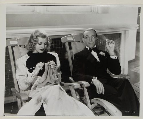 Ginger Rogers knitting with Fred Astaire on set