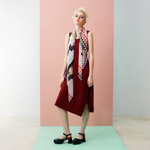 What makes the Panelled Hem Maxi Dress a wardrobe essential is its ability to anchor statement pieces and accessories. Featuring: Cream Chilli Crab Square Scarf. The Chilli Crab print is the first in Reckless Ericka's self-owned and designed textile print