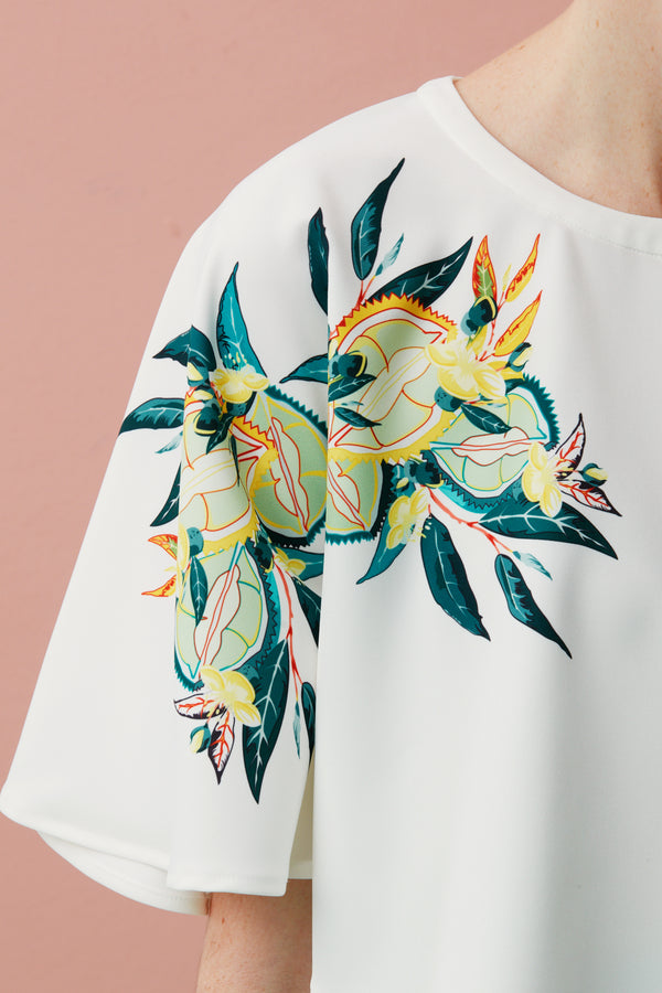 It's the Durian season! The most incredible, most unique fruit. This is Durian. Singapore fashion designer, Afton Chen, has sketched original designs, with the Durian fruit, flowers and leaves, artistically fusing food and fashion in her latest collection