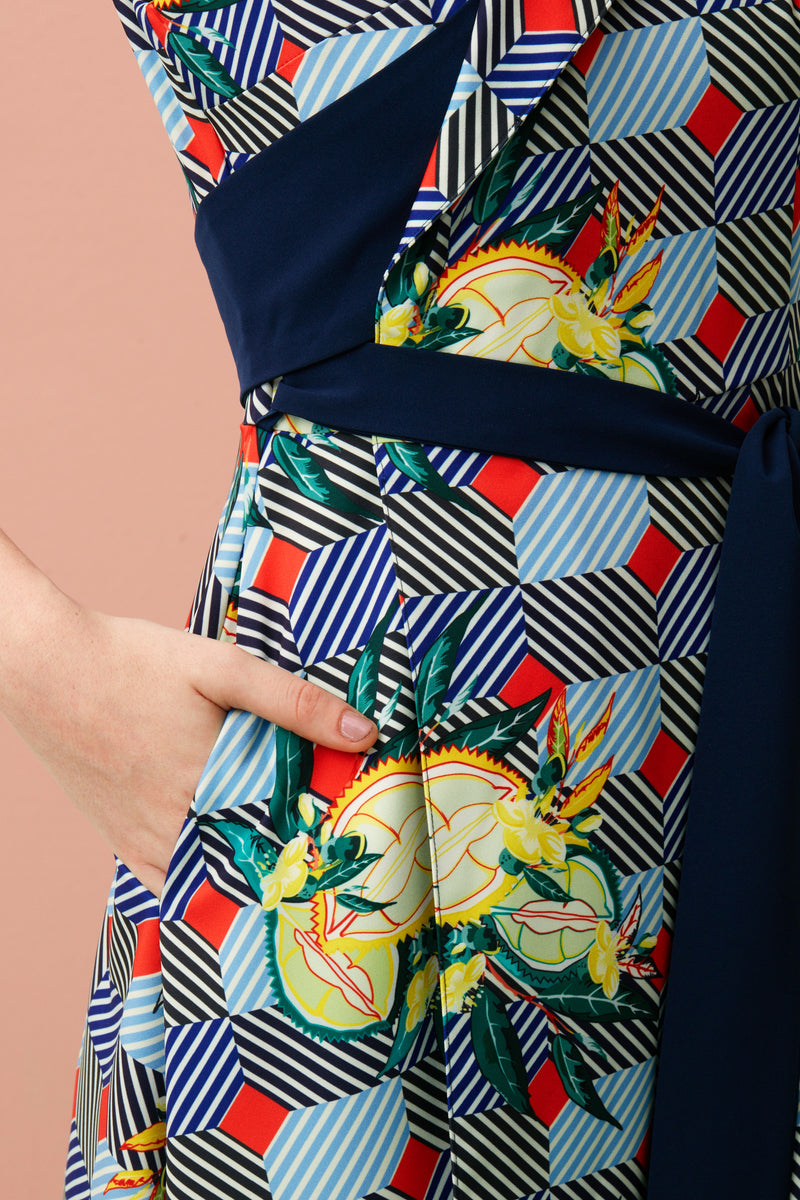 Our Sleeveless Wrap Dress has a sash that tunnels through the front to cinch the waist, giving the look a polished and relaxed vibe. The Durian print series was inspired by the vibrancy and designs found on façades of shophouses, where many durian stalls in Singapore are found.