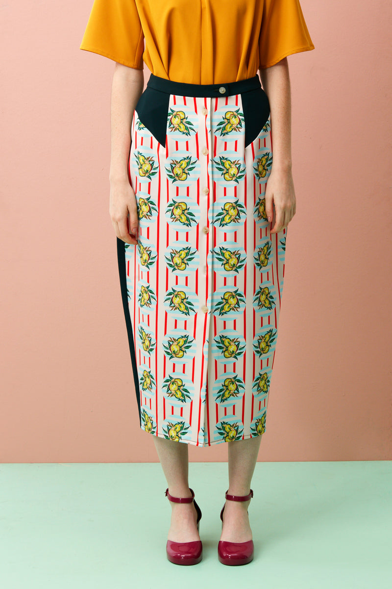 The Pencil skirt is one of the most timeless silhouettes and with a good reason too! With a tucked-in blouse, belted jacket for a suit look, slinky camisole or our Raglan Swing Top(as pictured), the pencil skirt gives you a long, lean line. The Durian print series was inspired by the vibrancy and designs found on façades of shophouses, where many durian stalls in Singapore are found.