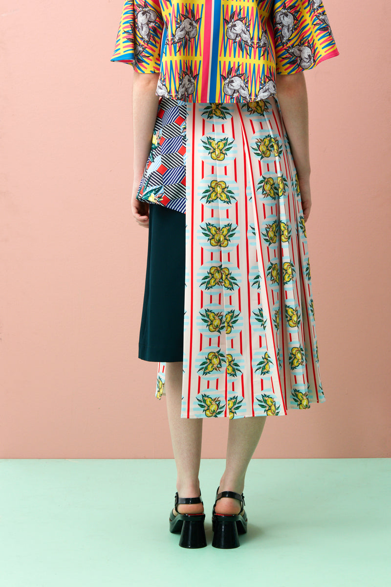 Printed Midi Peplum Skirt for women. The Durian print series are original RECKLESS ERICKA designs in vibrant colours and strong graphical elements, inspired by iconic Peranakan tiles of shophouses, where many durian stalls in Singapore are found.