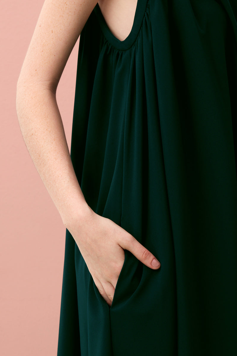 If sharply asymmetrical looks aren't your thing, slip on our effortlessly chic V-Neck Dress that gently slopes longer at the back hem. Made with our smooth and comfortable Tencel, this is the ultimate soft drape dress. V-Neck Gathered Maxi (Forest Green).