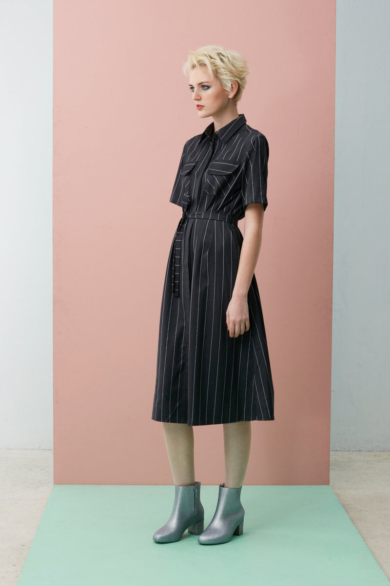 Cut from our favourite pin stripe fabric, this timeless shirt dress can be styled loose or nipped at the waist with our thin sash to define your figure. Pair it with minimalist jewellery and white sneakers for a preppy look while a bright pair of sandals will capture the spirit of summer.