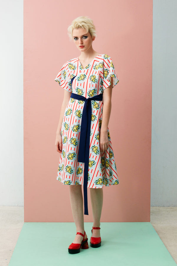 Midi Wrap Dress for women. Flutter Sleeve Dress in Hong Xia print. The Durian print series are original RECKLESS ERICKA designs in vibrant colours and strong graphical elements, inspired by iconic Peranakan tiles of shophouses, where many durian stalls in Singapore are found.
