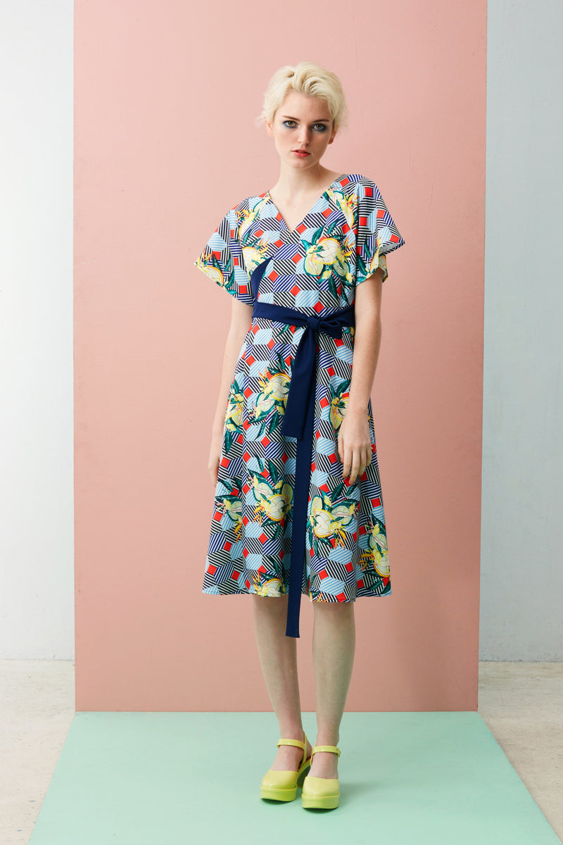 Our Wrap Dress has a waist-defining style with flutter sleeves that lend softness to this versatile and classic dress. The Durian print series was inspired by the vibrancy and designs found on façades of shophouses, where many durian stalls in Singapore are found.