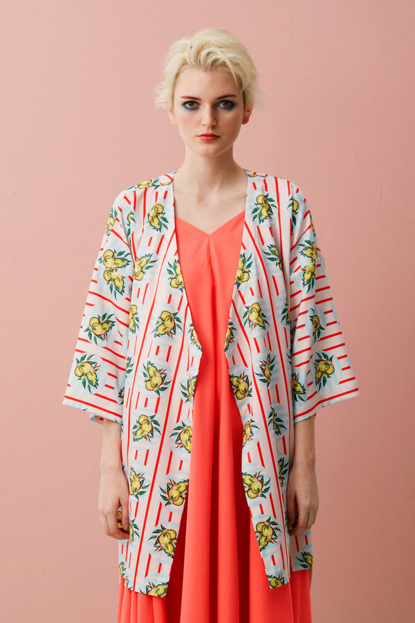 Printed Midi Kimono Jacket for Men and Women. Kimono Jacket in Hong Xia print. Made with Tencel. The Durian print series are original RECKLESS ERICKA's designs in vibrant colours and strong graphical elements, inspired by iconic Peranakan tiles of shophouses, where many durian stalls in Singapore are found.