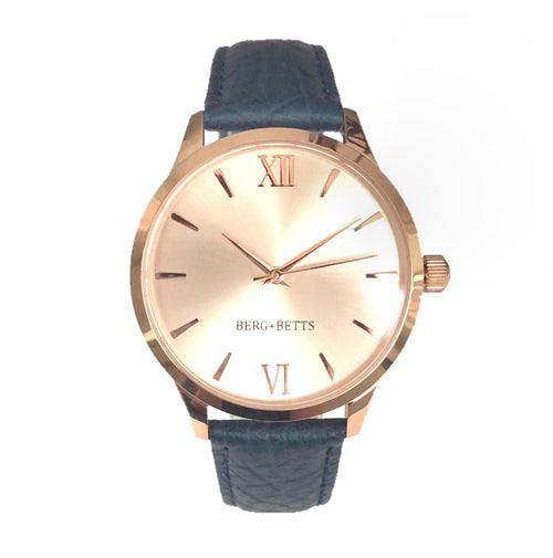 Round rose gold watch with minimalistic design with sustainable leather strap in navy