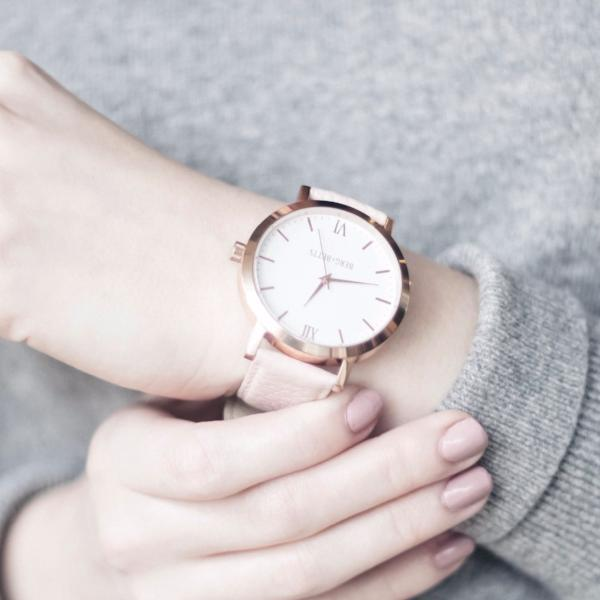 ethical rose gold and blush round watch