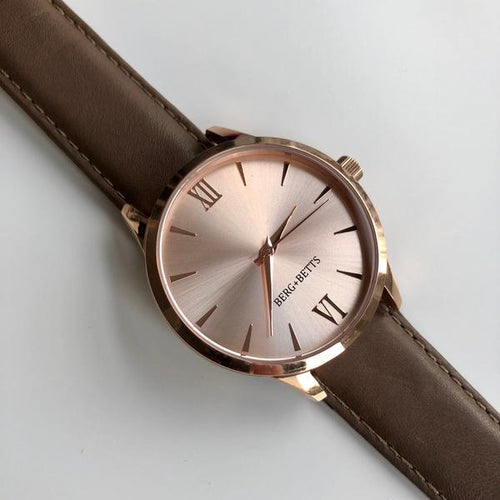 Minimalistic round rose gold watch with brown strap made from recycled leather