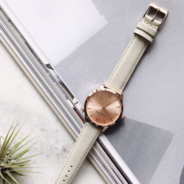 Minimalistic round gold watch with ivory strap made from recycled leather