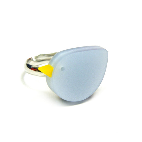 cute abstract blue bird with yellow beak on an adjustable silver ring