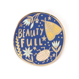 Circular blue Beauty Full lapel pin with insect and flower illustration