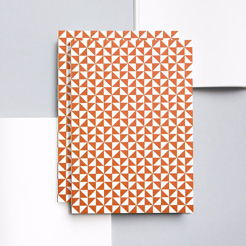 A5 notebook with red triangle geometric print pattern on cover