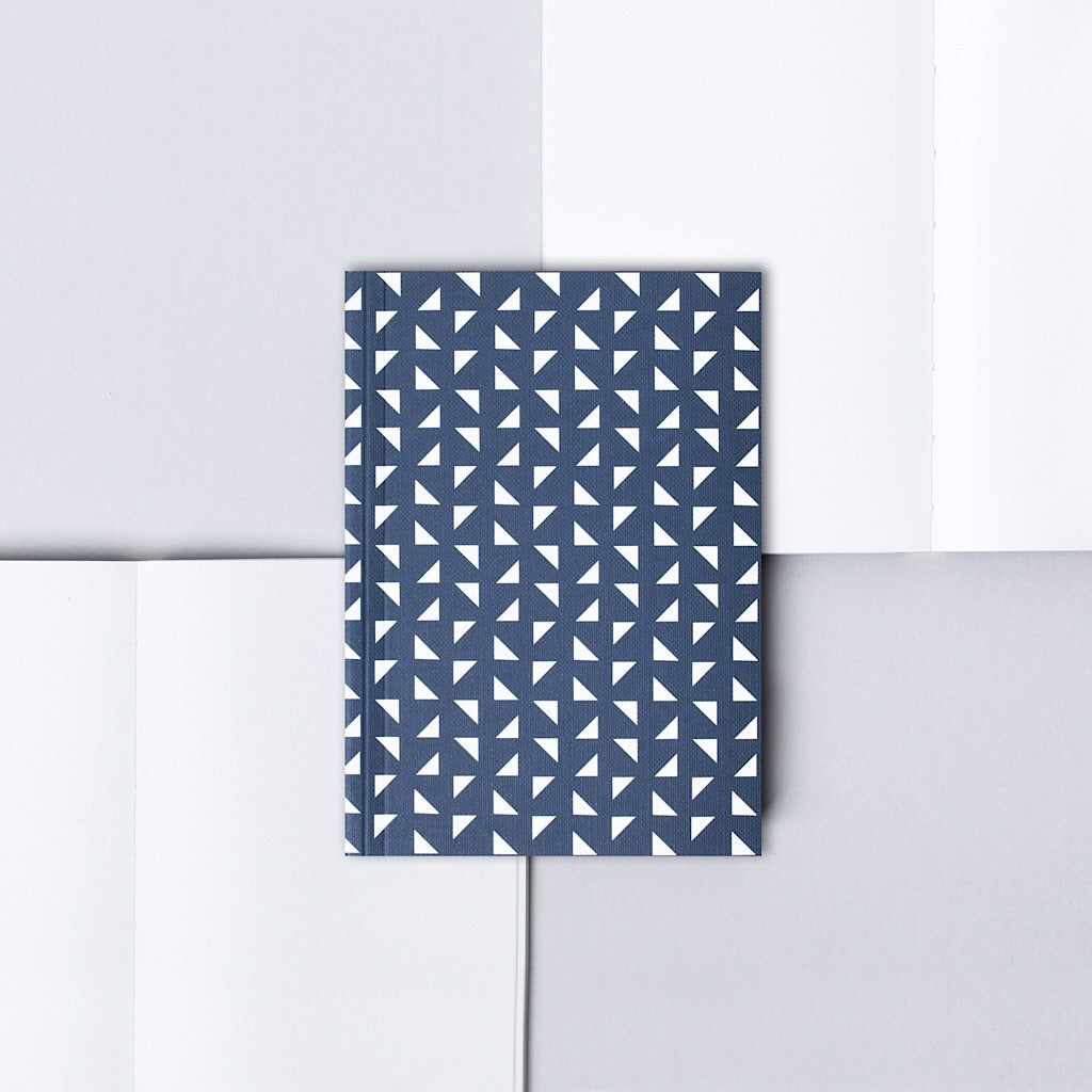 A6 small notebook with minimal geometric patterned cover in navy blue and white