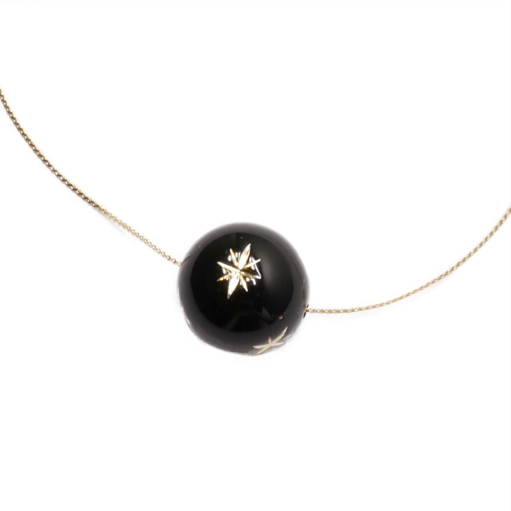 Dotpop starry sky black opaque gold star pattern bead necklace on gold snake chain