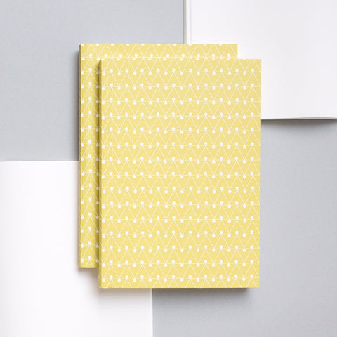 A5 notebook with soft textured cover in leaf green with a geometric white pattern print