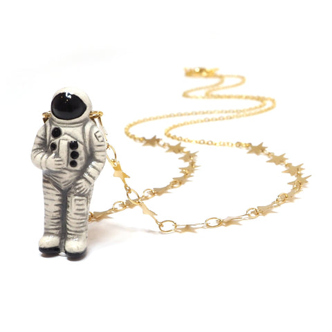 Eclectic Eccentricity - Ceramic Astronaut Figure Necklace on Gold Chain with Star Embellishment