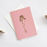 Pretty pink greeting card with foil blocked flower illustration and cream envelope