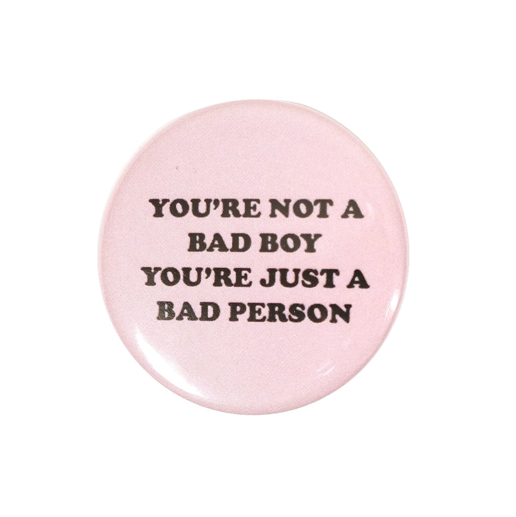 pink your not a bad boy your just a bad person button badge