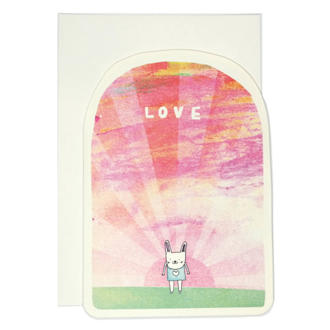 Romantic valentines card with cute white bunny rabbit against pink sky with word love