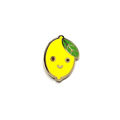 miniature enamel lemon pin with smiley face by scout editions