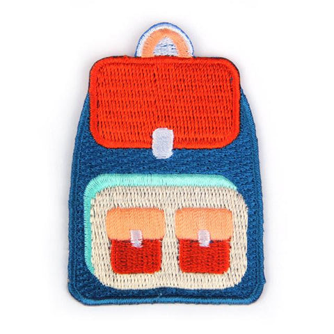 Mokuyobi threads iron-on backpack shaped embroidered patch, blue with rust orange pockets.