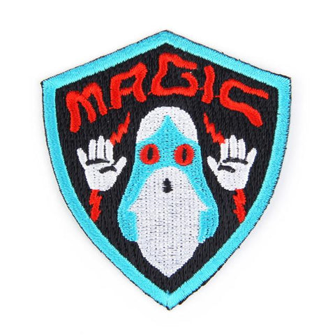 Mokuyobi threads Magic wizard embroidered iron-on patch - shield shaped design with blue bearded wizard casting a spell